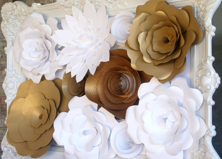 A custom large Paper Wall Flower installation in Gold and White.  This would be a stunning ceremony...
