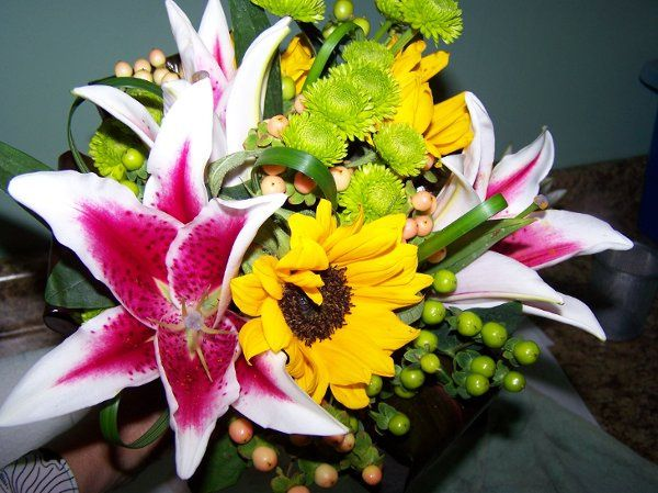 stargazer lily, sunflower, athos, pink and green hypericum and lily grass accents bouquet