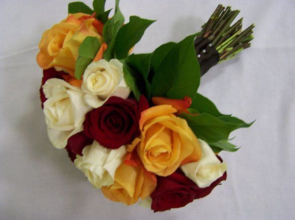Classic orange, deep red and ivory rose bouquet