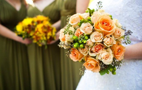 pale peach and medium peach roses with green hypericum and seeded eucalyptus accents