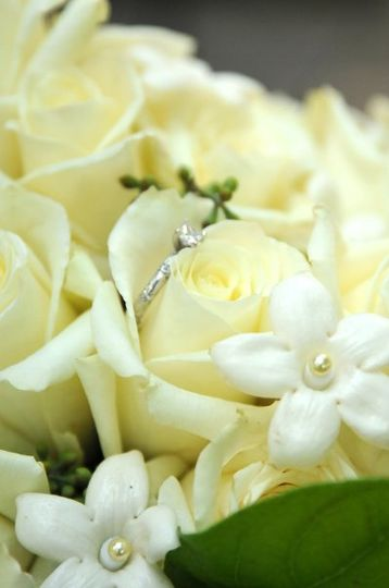 Ivory roses, stephanotis with pearl center bridal bouquet