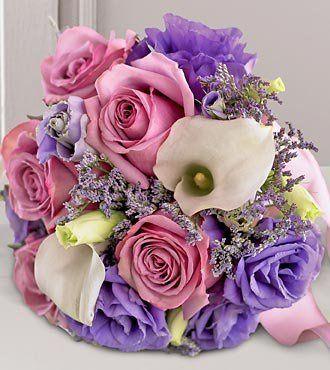 Open mauve roses, mini-calla lily, purple lisianthus and limonium bouquet