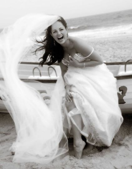 Christy laughing and enjoying her wedding day.   As they say, Live, Love and Laugh.  Picture taken...