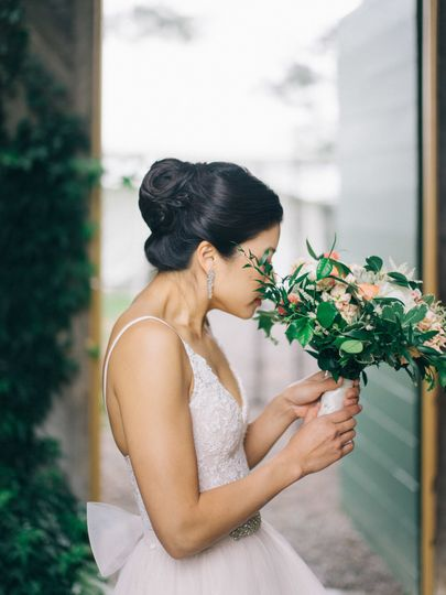 Bride smelling her flowers