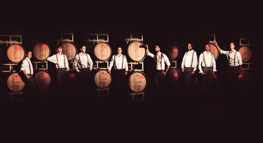 Groomsmen in the barrel cellar