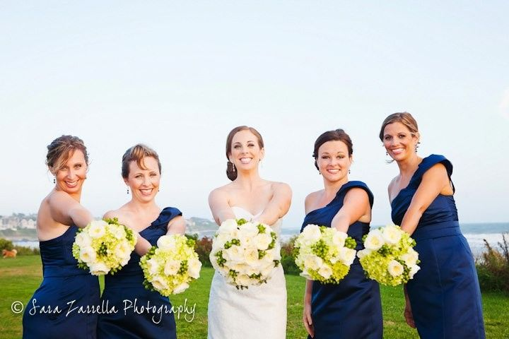 Bride and bridesmaids holding out their bouquets