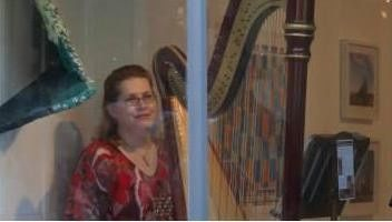 Harpist in the Window! Public ribbon cutting ceremony of an new art museum.