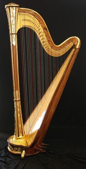 The gilded concert harp.
