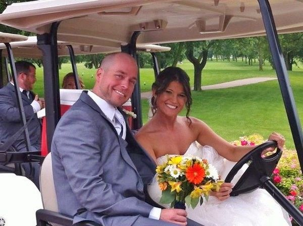 Couple in the golf car