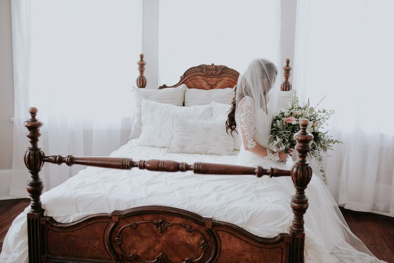 Bride on the bed | Connie Marina Photography