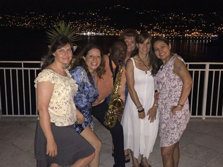 These beautiful ladies and their group enjoyed dancing to Saxophone Serenade music by Clinton during...