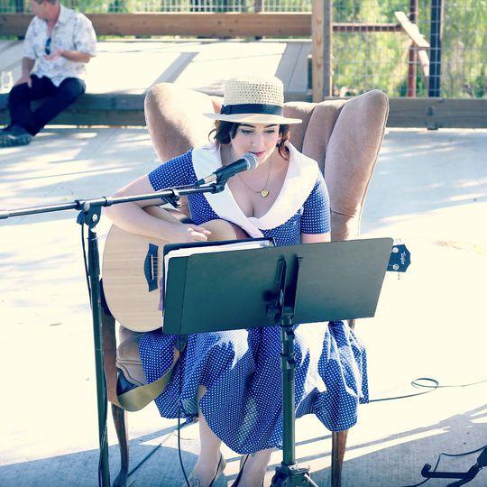 Rachelle providing acoustic accompaniment