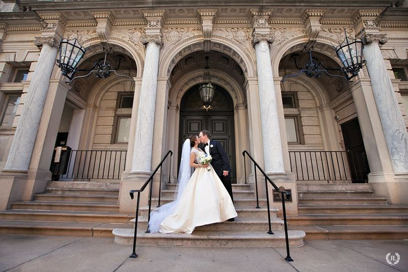 Couple kissing at the steps