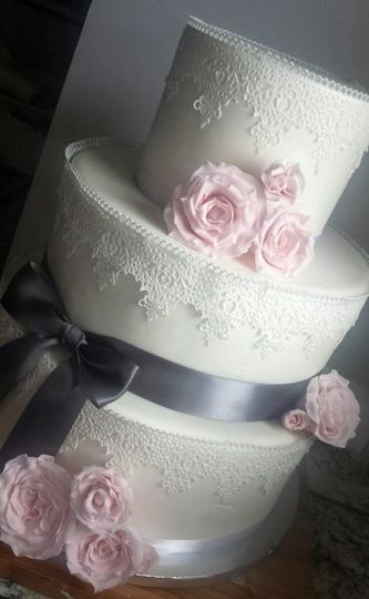 White wedding cake with ribbon