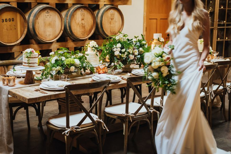 Bride by the rustic head table