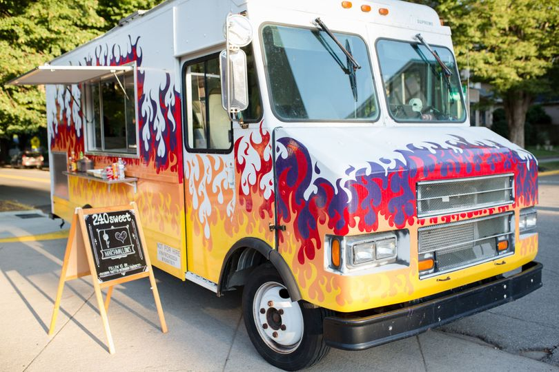 Our Flaming Food Truck serves your choice of tacos, barbecue, or s'mores!