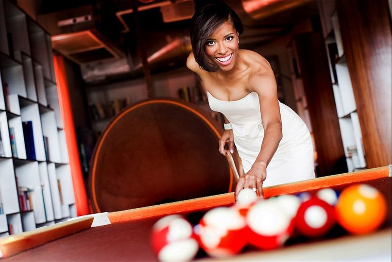 Bride playing pool
