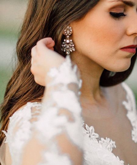 Bridal dress details and earrings