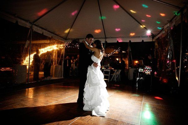 Michael & Thao look beautiful dancing under the tent and lights.