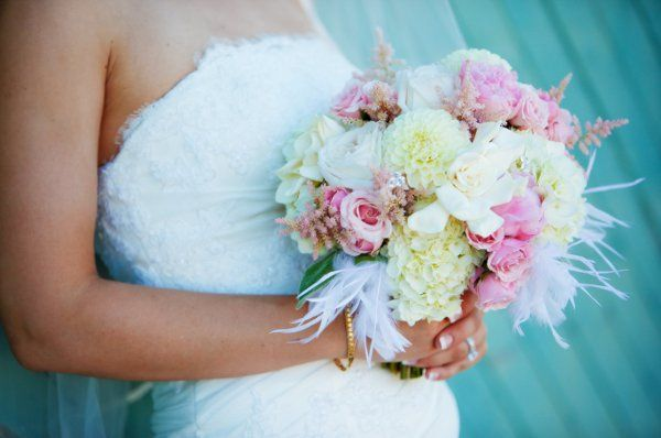 Bridal bouquet with pink roses, astilbe, peonies, hydrangea, gardenias, and dahlias