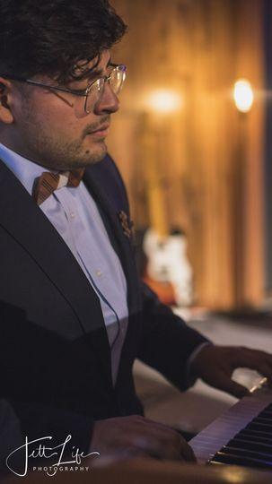 Oswaldo serenading his new wife Dayana