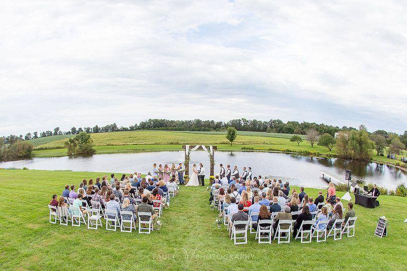 Ceremony by the pondWeddings by Paul V