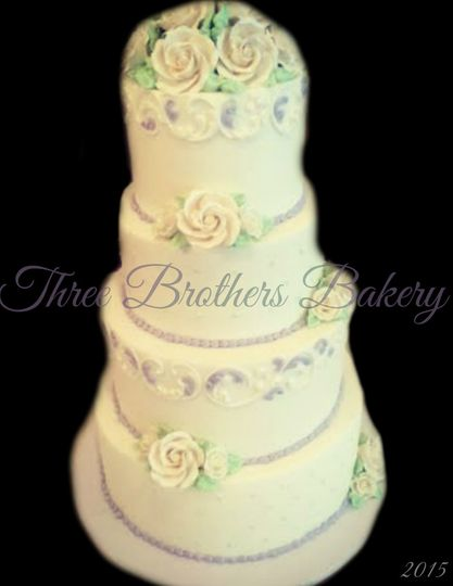 White wedding cake with flowers on top