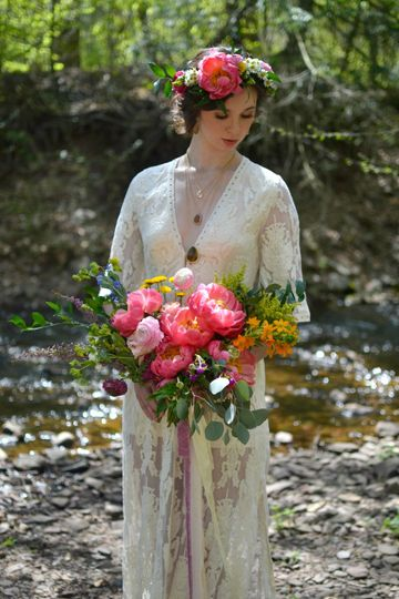 Sleeved wedding dress and bridal bouquet