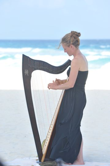 Harp performance at a beach wedding in Mexico