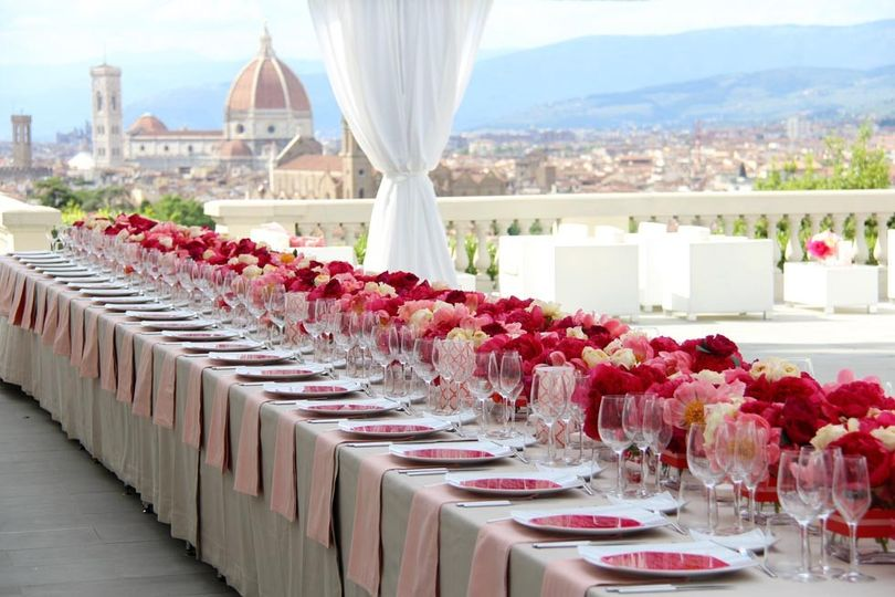 Long tables with red roses