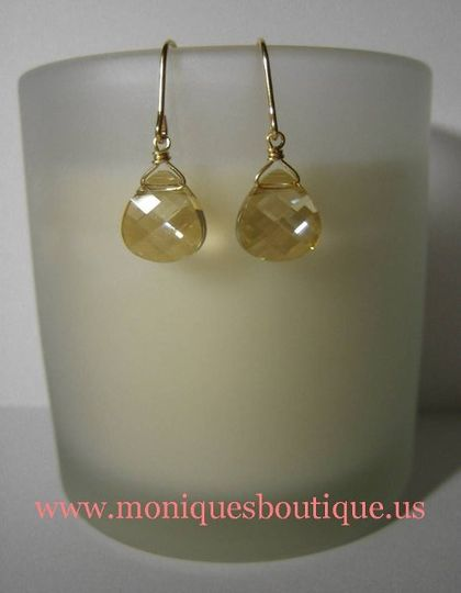 Single briolette earrings with Swarovski crystal flat briolettes and gold metal. Your choice of...