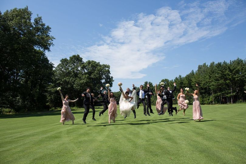 The couple with the bridesmaids and groomsmen jumpshot