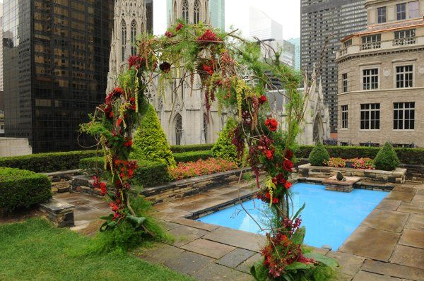 Wysteria vines, amaranthus, roses and orchids were used to frame the ceremony at Rockefeller Center.