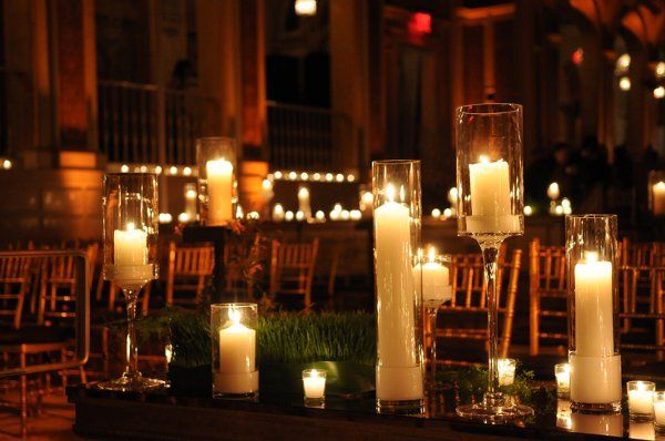 Numerous pillar candles create an elegant, romantic atmosphere for the ceremony.