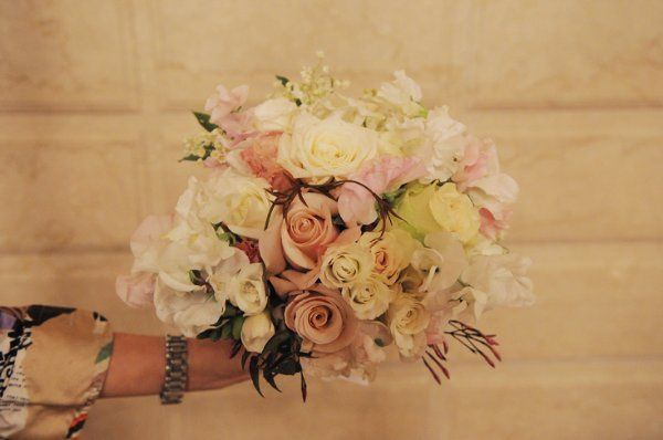 Lush and romantic, this fragrant bridal bouquet includes garden roses and lily of the valley.