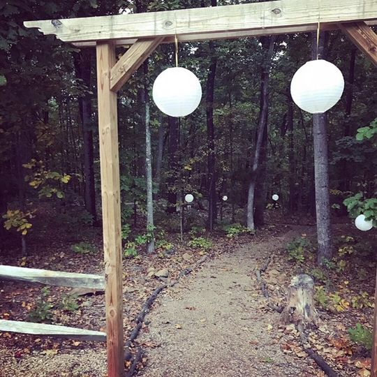 Globe lit archways into the forest
