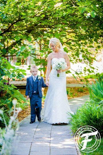 Bride and her junior groomsman