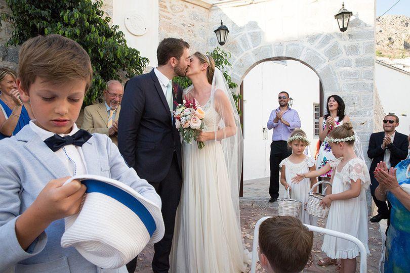 Newlyweds sharing a kiss