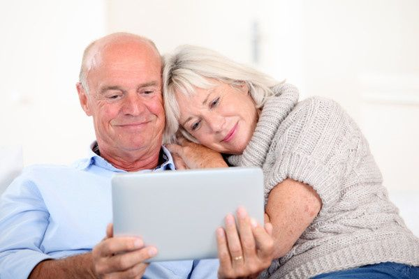 older couple watching video