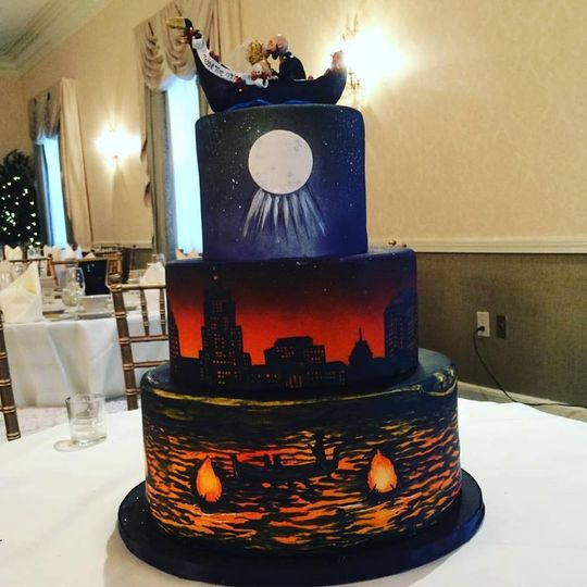 Painted Waterfire cake with custom made topper