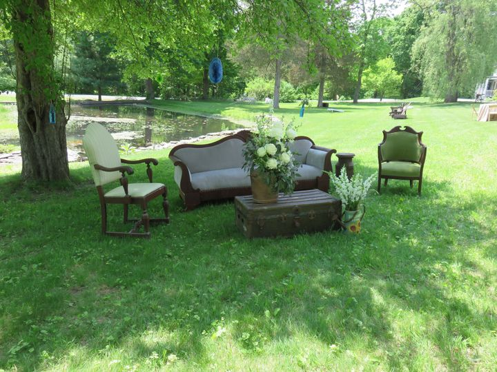 Vintage furniture set under the trees for cocktail hour.