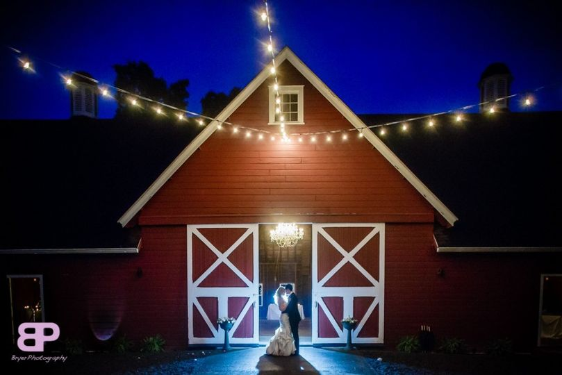 Main entrance to barn capturing the reflection from the rain and the glow of the chandelier and...