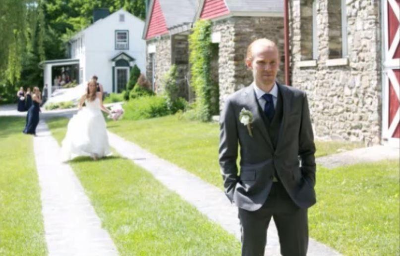 First Look.  Bride walking down the ribbon road toward her groom.