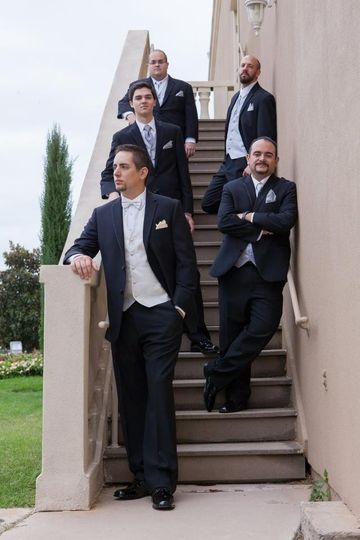 Groom and groomsmen on the stairs
