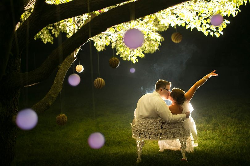 Bride and Groom celebrate with cigars at night after their wedding ceremony at a private residence...
