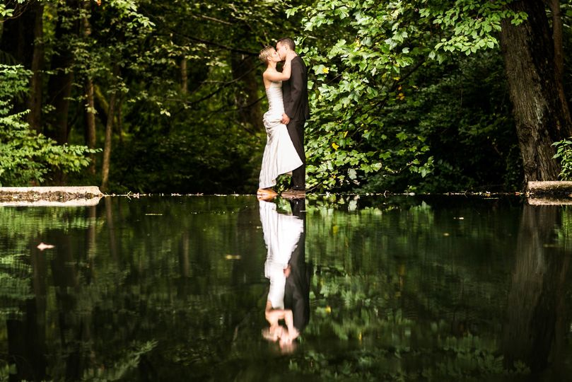 Bride and Groom on the lake of a private farm wedding in Bucks County PA. Image by Ben Weldon of...