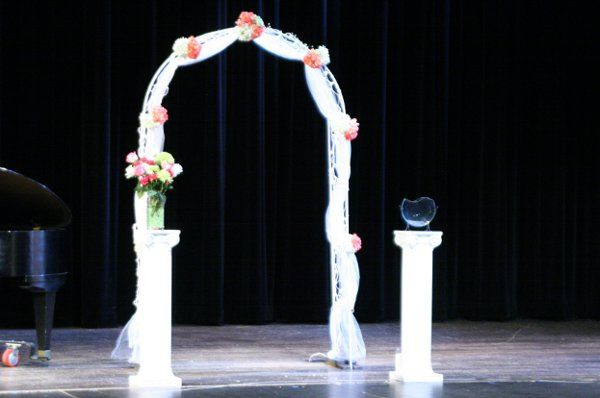 Decorated arch and sand ceremony container (in lieu of unity candle)