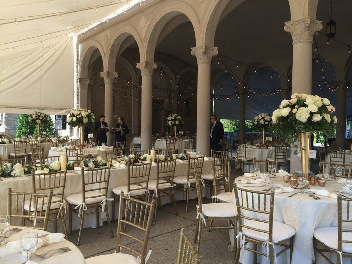 Tables with floral centerpieces