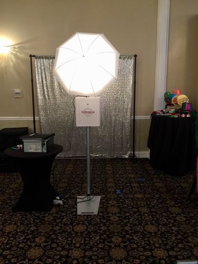 Luxury open air photo booth set up: choice of backdrop, custom props, unlimited prints, personalized...
