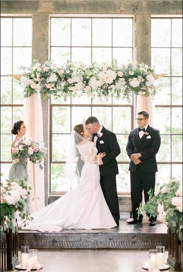 This epic ceremony shot is a true moment to remember, Poison Ivy Floral did such a beautiful job on...